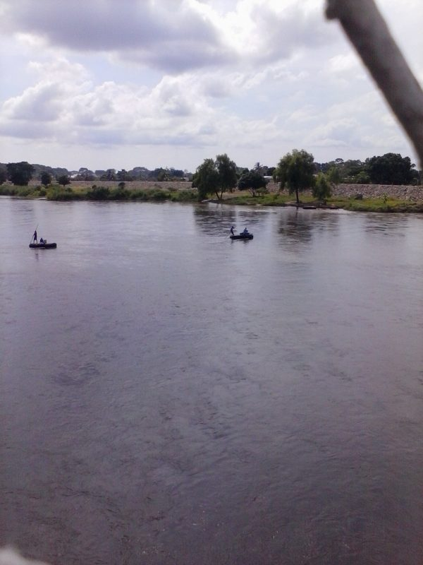 Two makeshift rafts crossing the border river between Mexico and Guatemala.